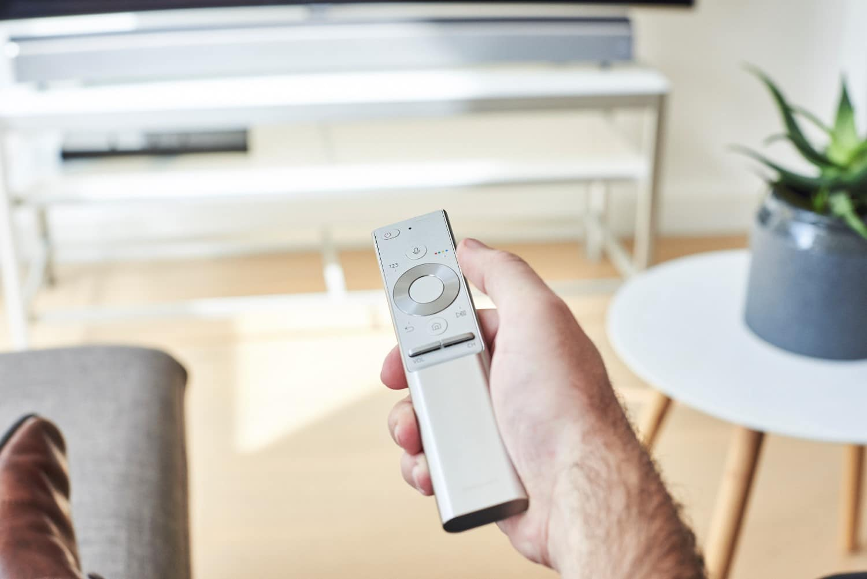 samsungs sound and soundbar remote on the hand