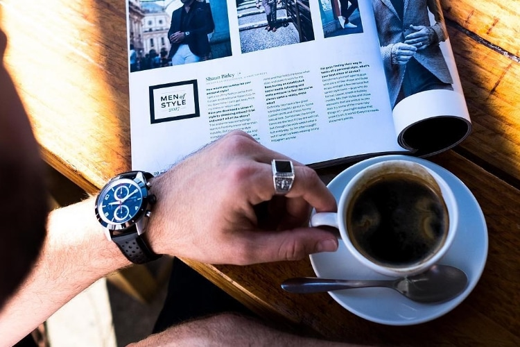 hand of watch and coffee