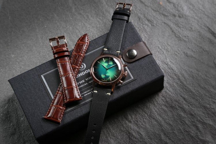 undone wrist watch with black and brown belt