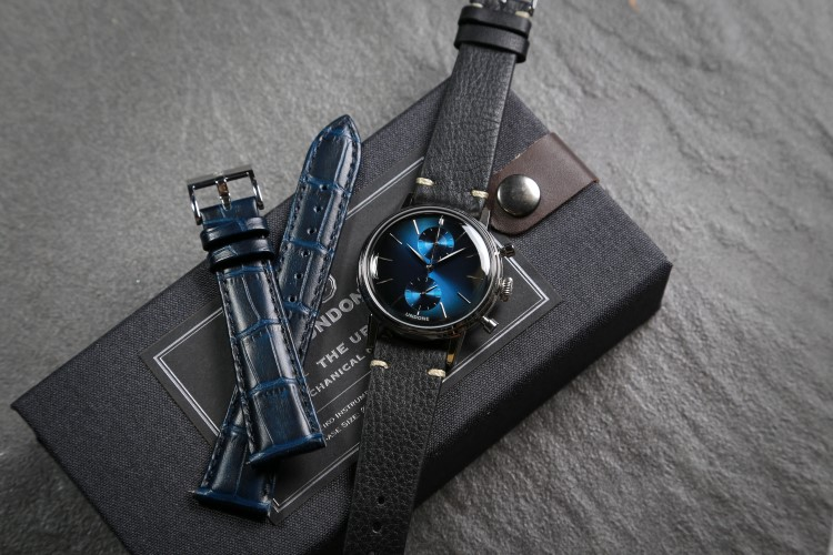 undone wrist watch with black and blue belt