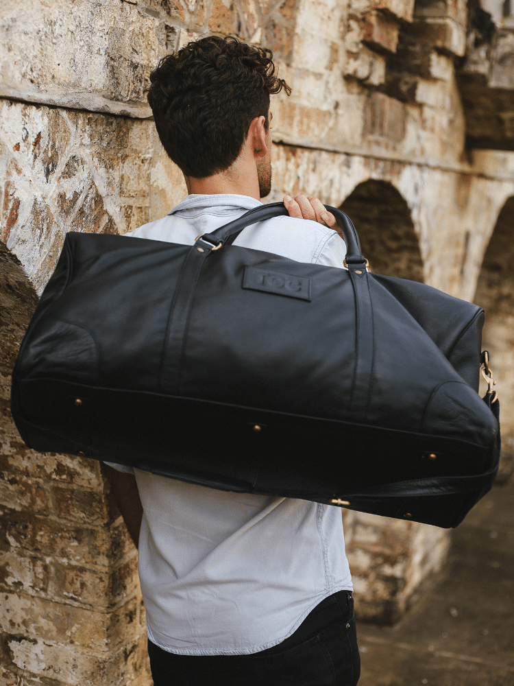 black toc leather bag carry by hand