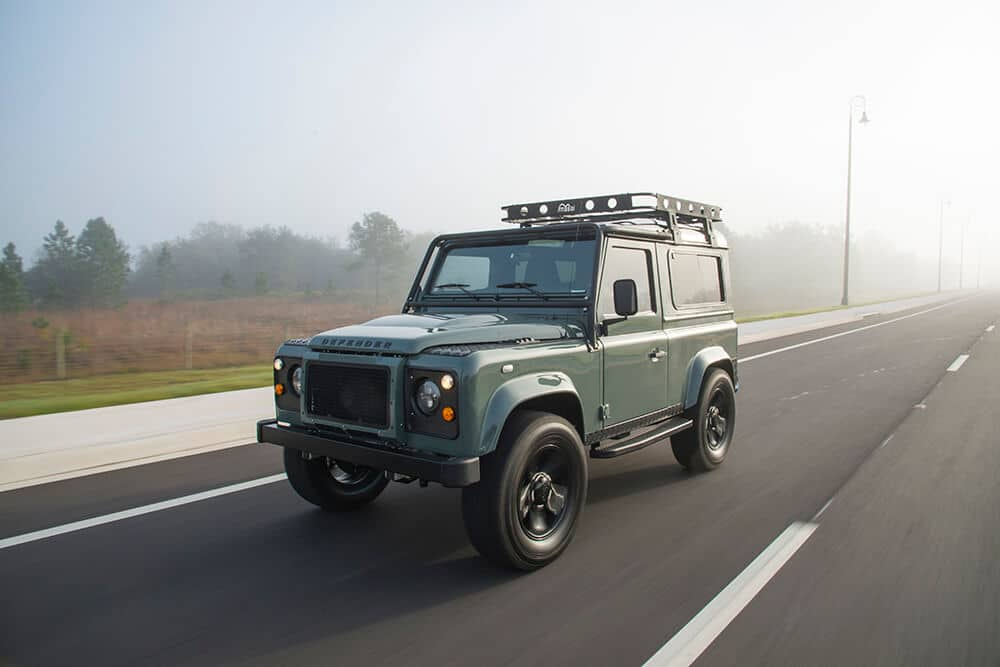 vintage land rover on the road