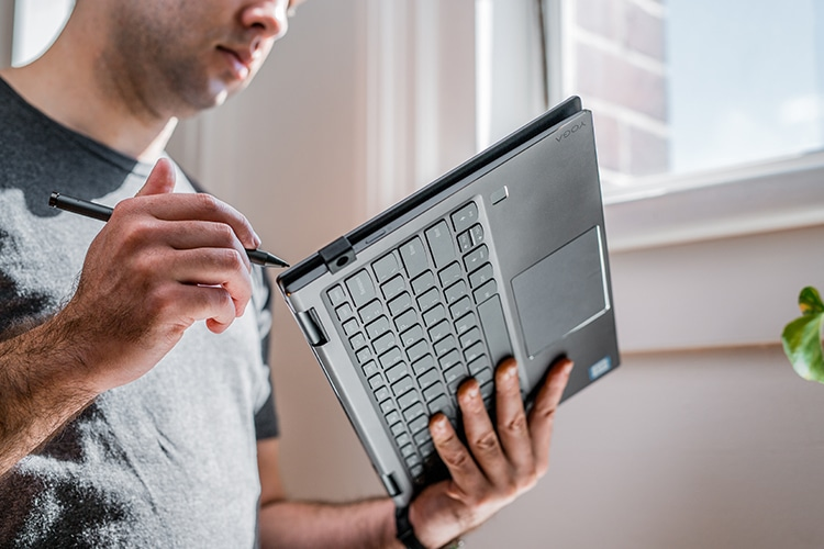 man working on laptop with touch pen