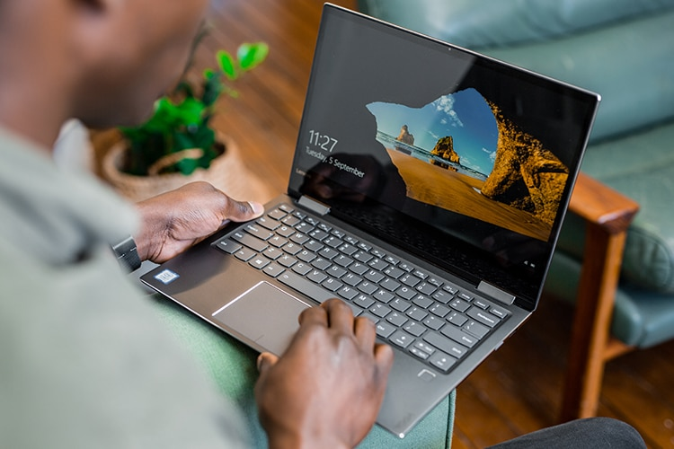 man work with windows 10 laptop