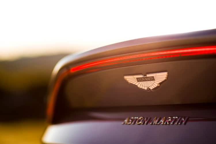 grey aston martin vantage car logo and lights