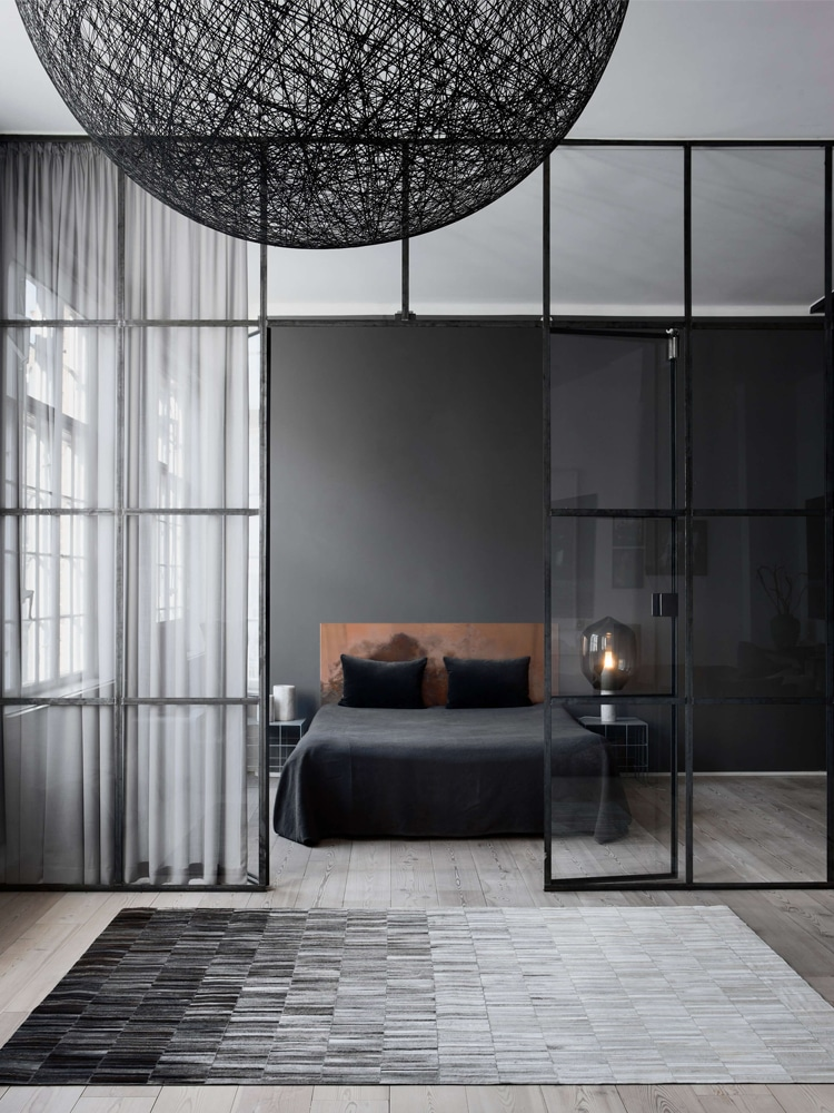 masculine bedroom with a glass door