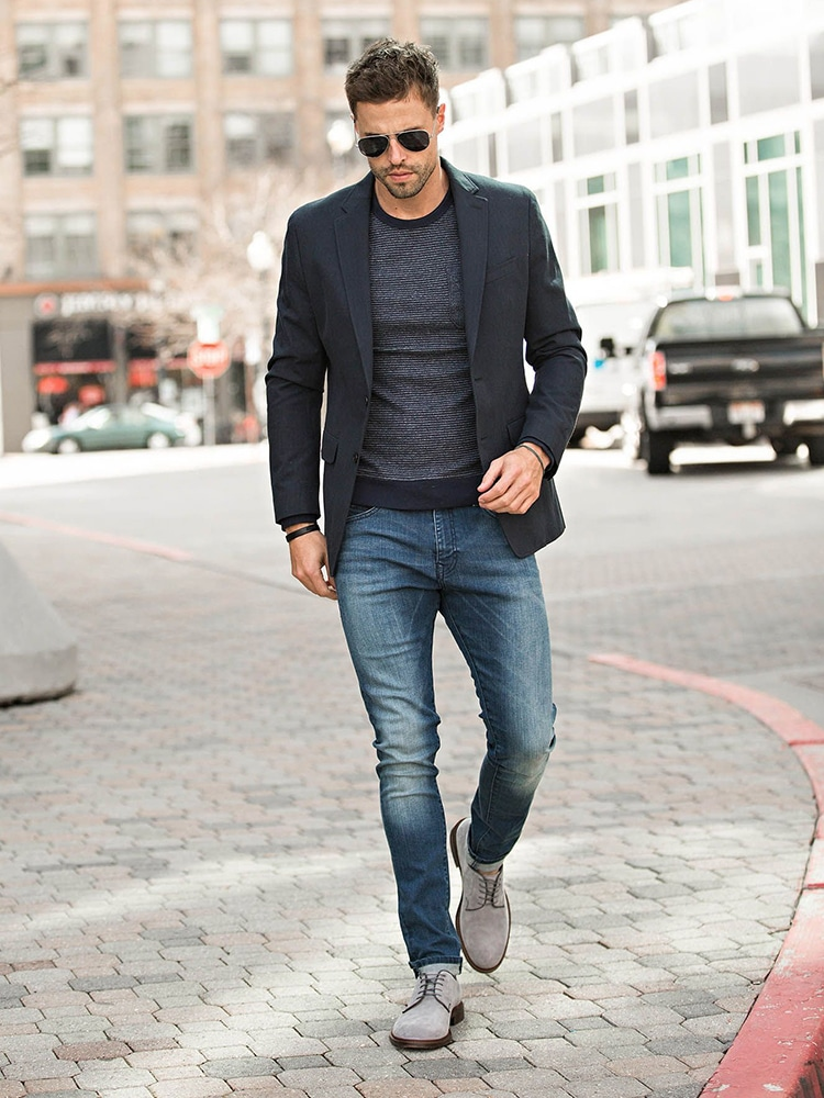 men walking jeans and suit