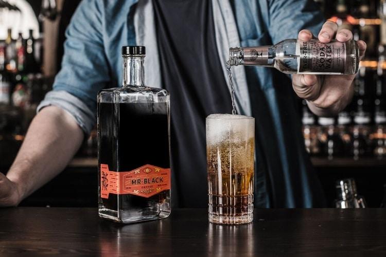 mr black coffee italian liqueur pour in glass
