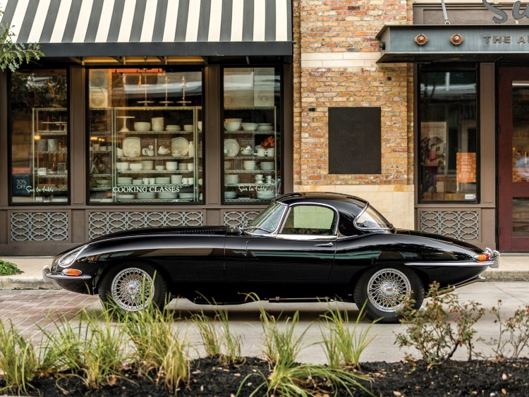 jaguar e-type car beside in the shop