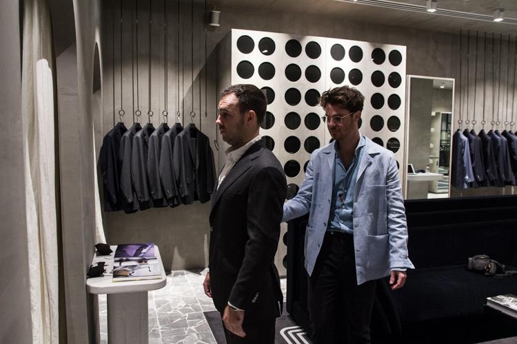 tailor help men wear suit