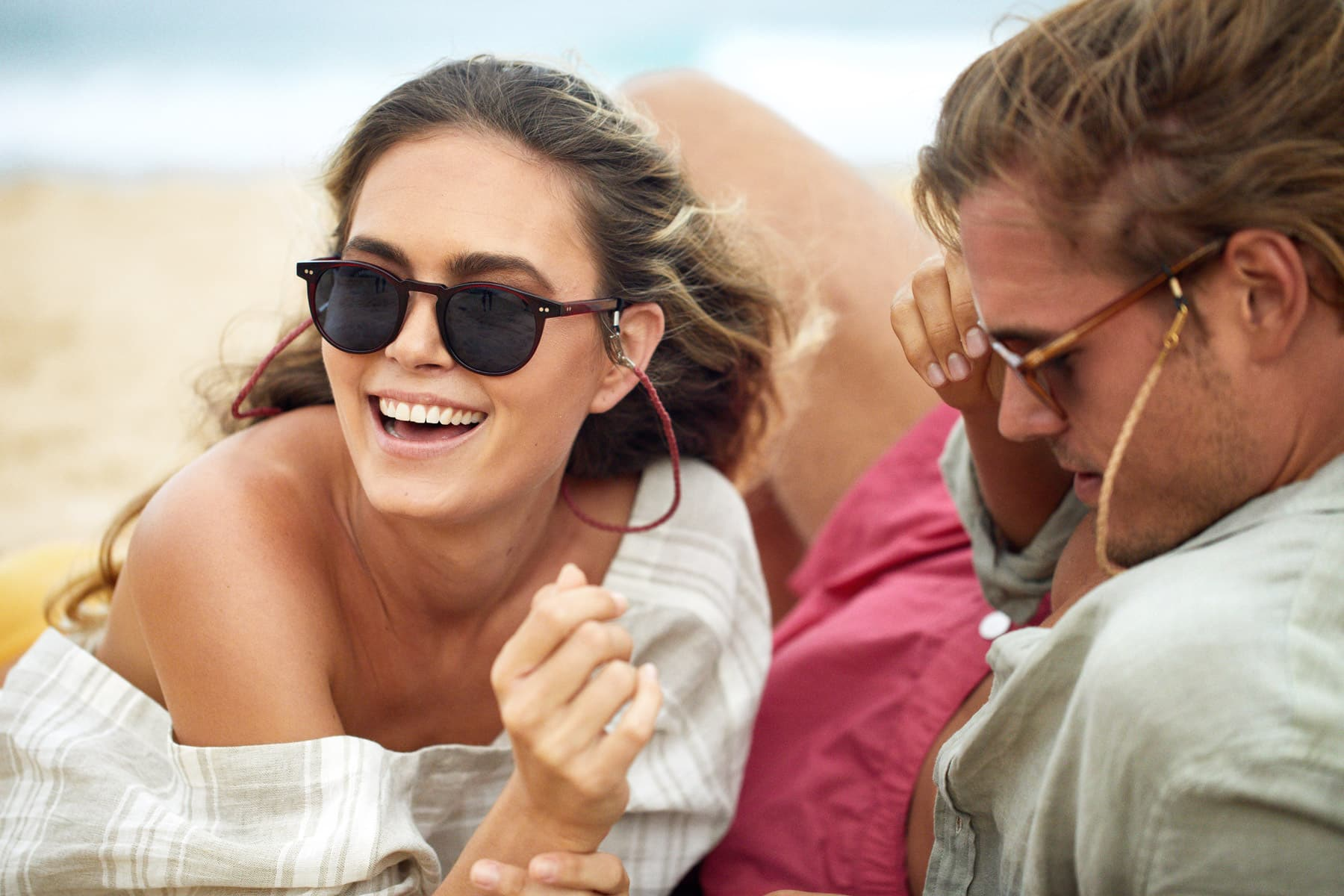x pacifico optical sunglass women smiling