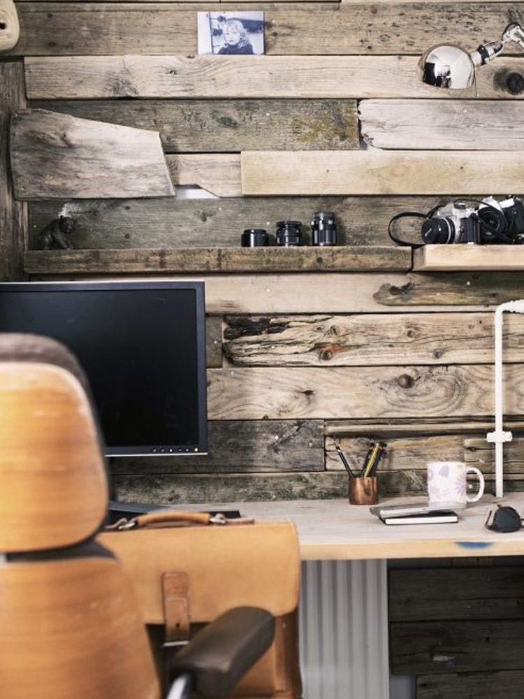 masculine home office wood wall