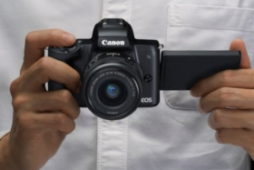 canon 4k digital camera on hand