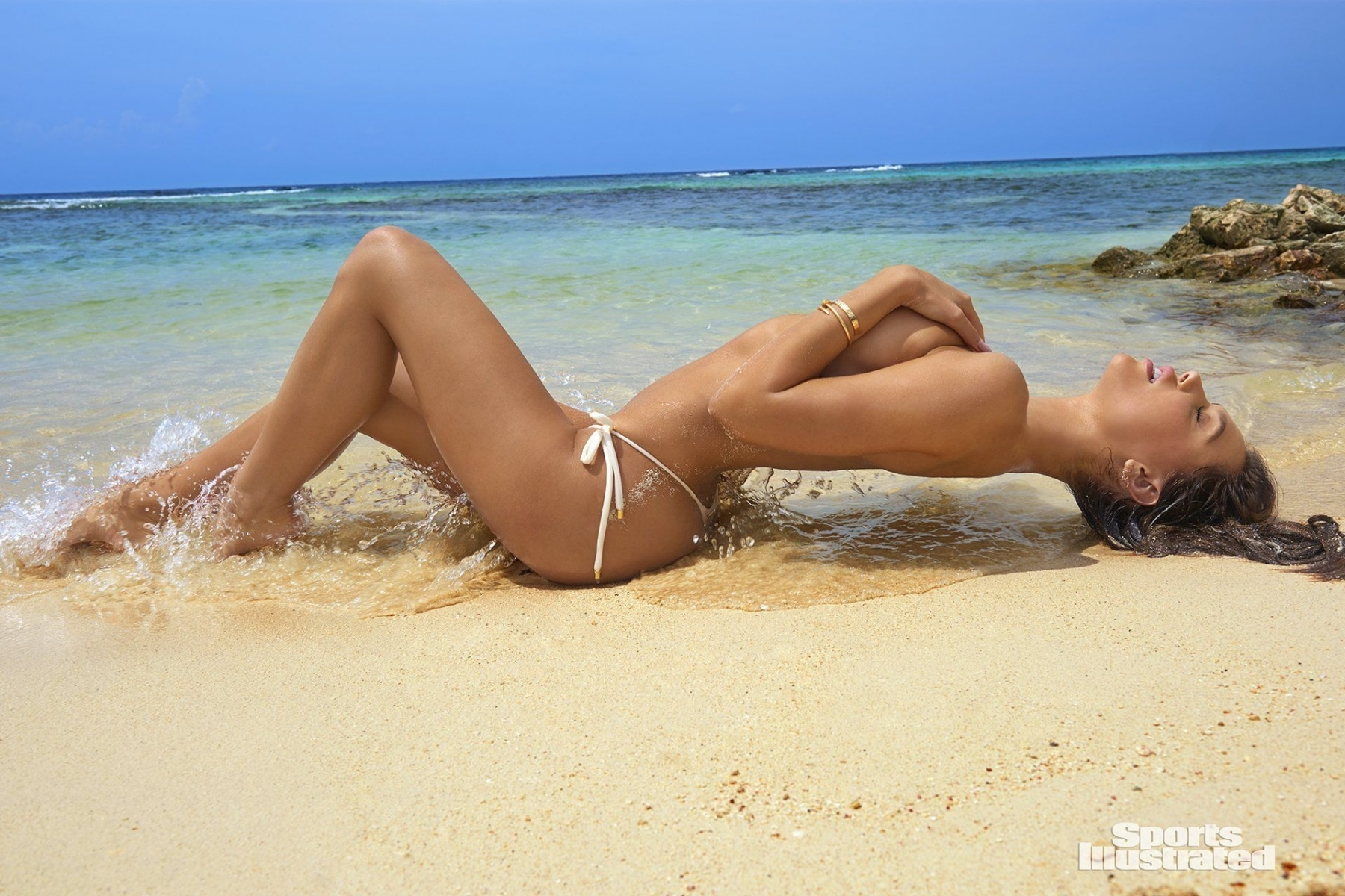 alexis ren lying down in the sand