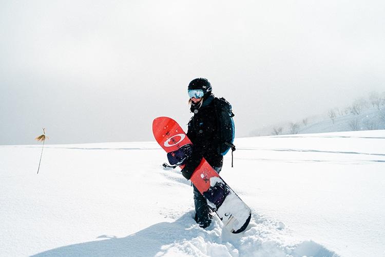 men standing motion on snow