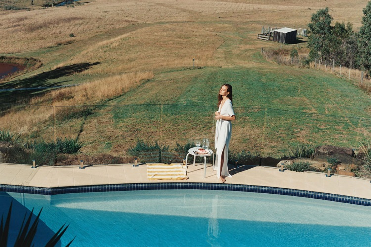 sophia tatum standing beside swimming pool