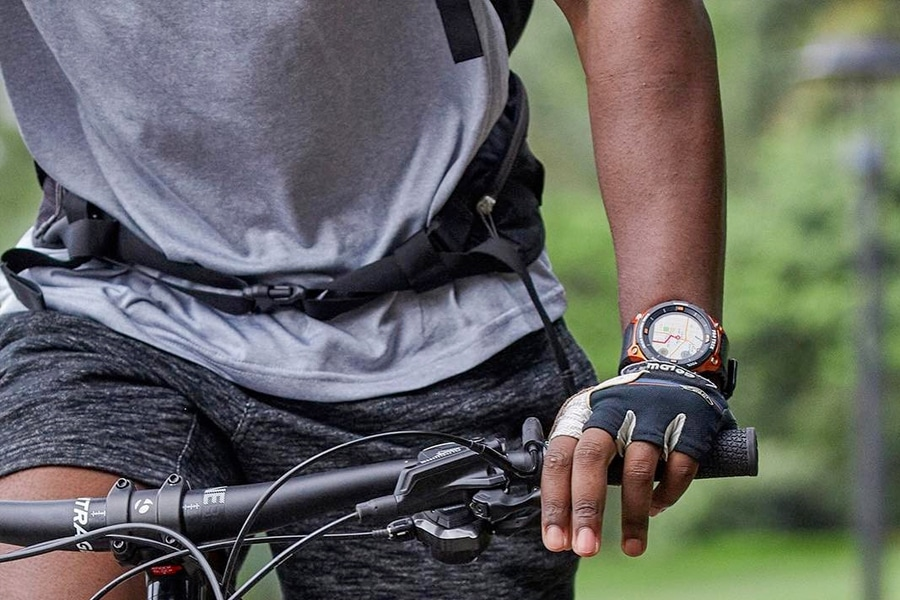 cyclist sporting high end tactical watch