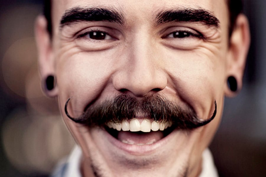 Handlebar mustache with stretched ear piercing