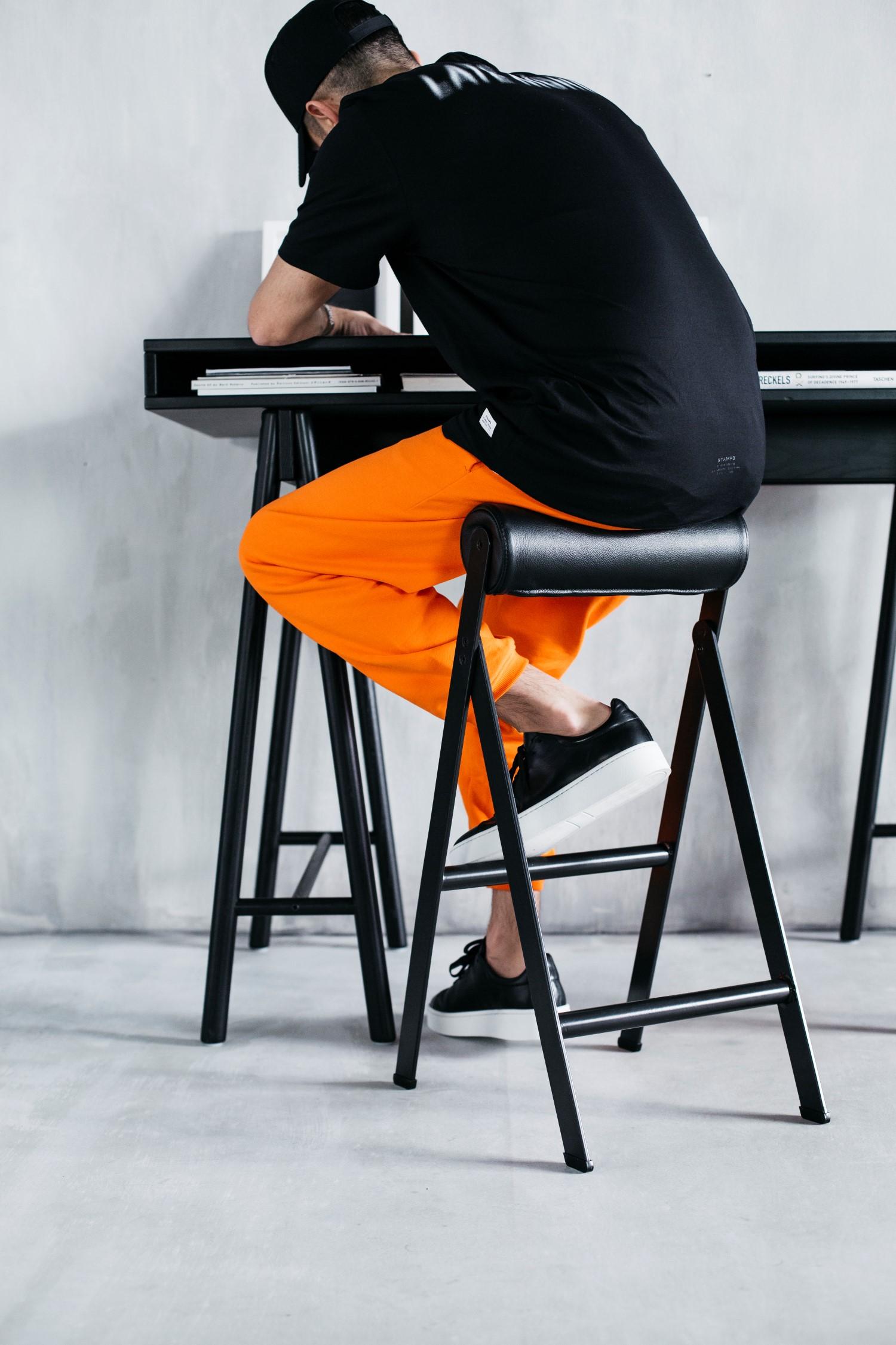 ikea spanst men sitting on the stool