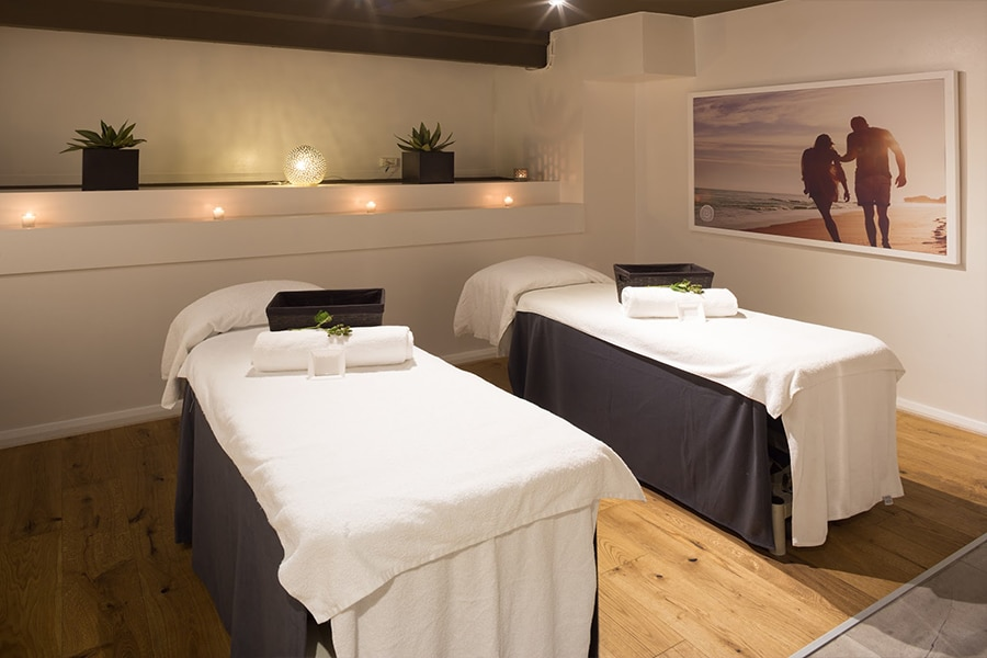 massage room with two single beds