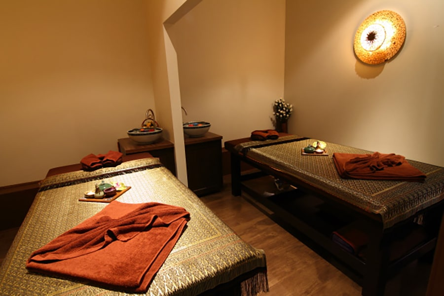 thai style massage room with 2 single beds