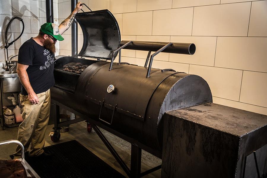bovine and swine chef opening bbq roaster
