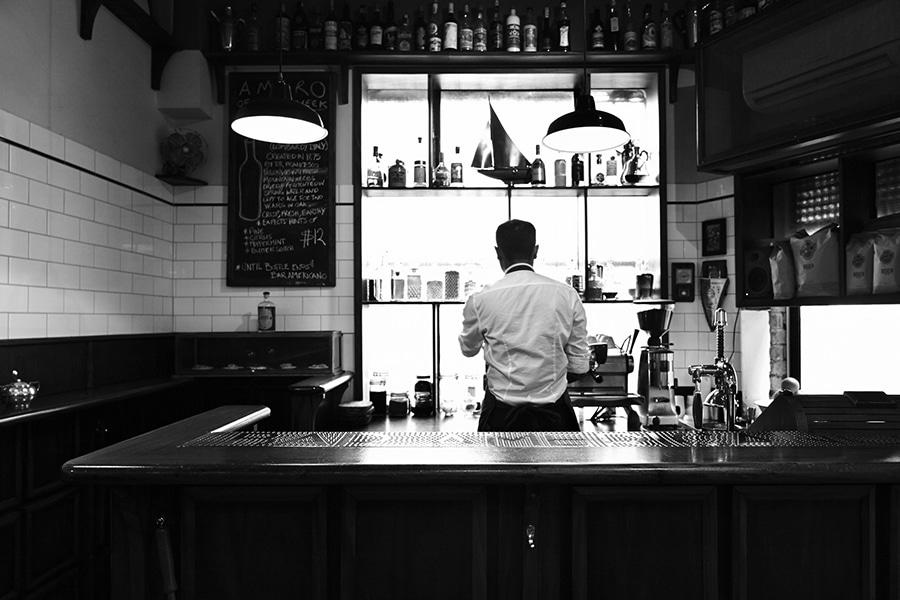 bar americano bartender black and white