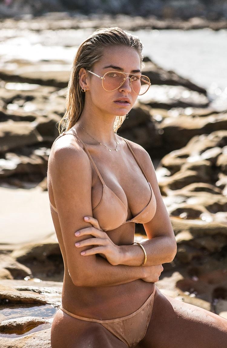 madi edwards standing beside beach