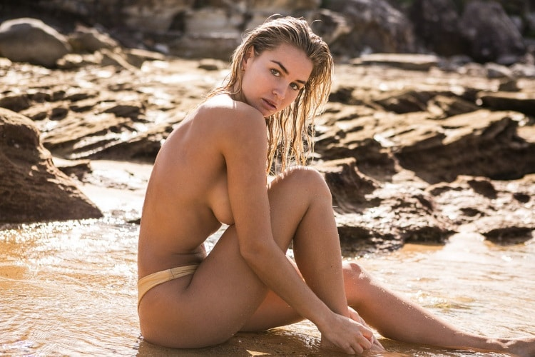 madi edwards sitting in the beach