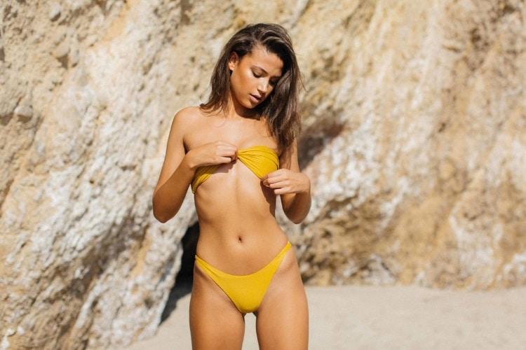 candice blackburn standing in the beach