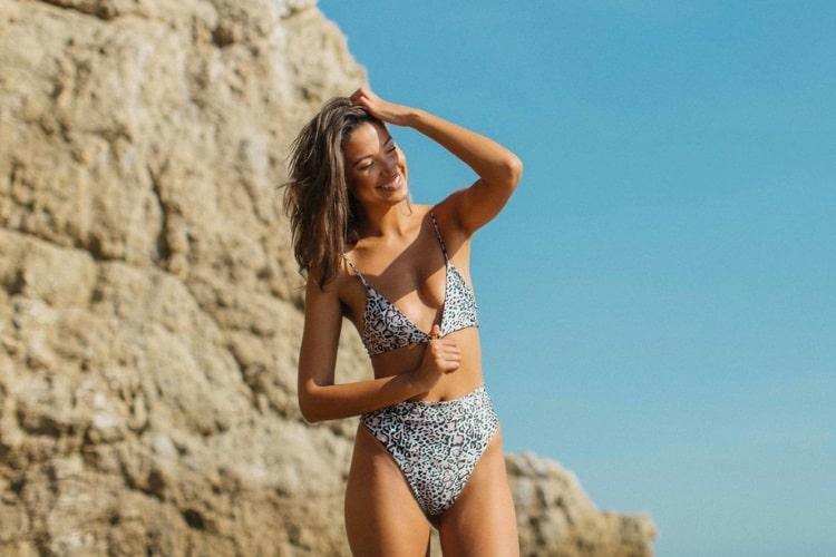 candice blackburn smiling with wearing bikini
