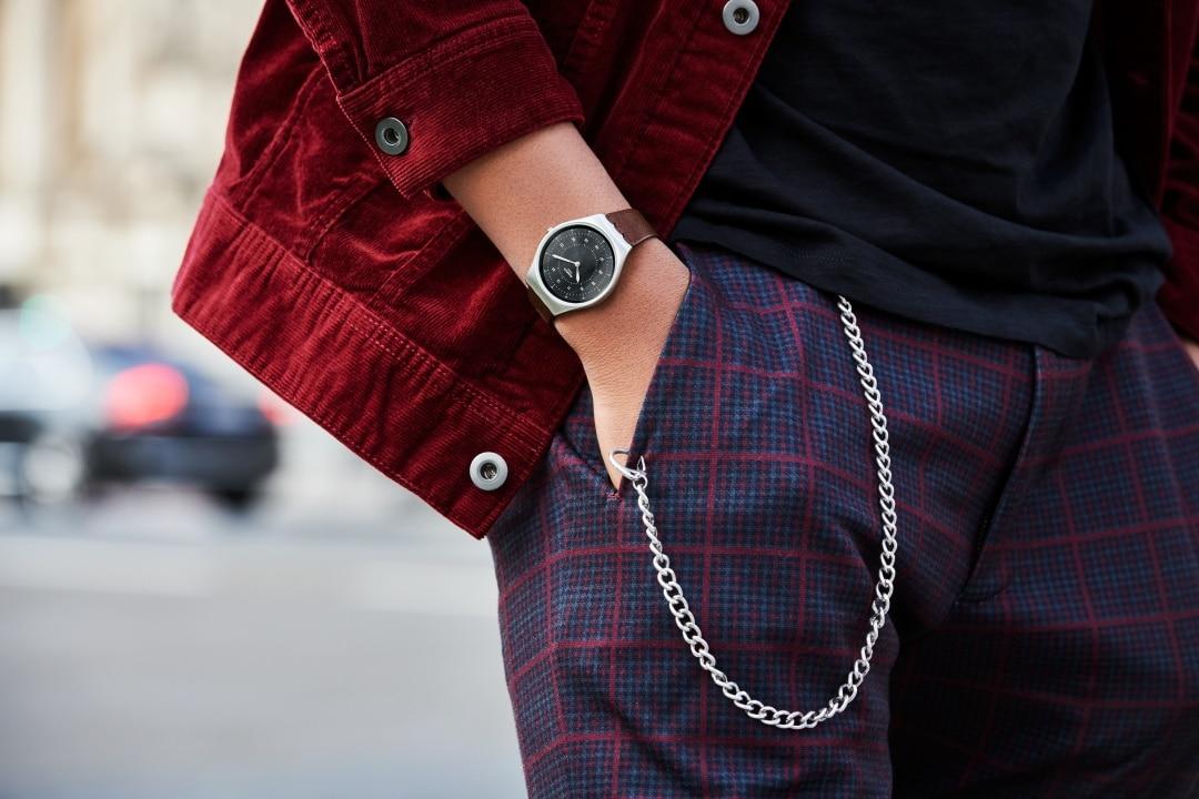swatch skin irony watch wear in hand