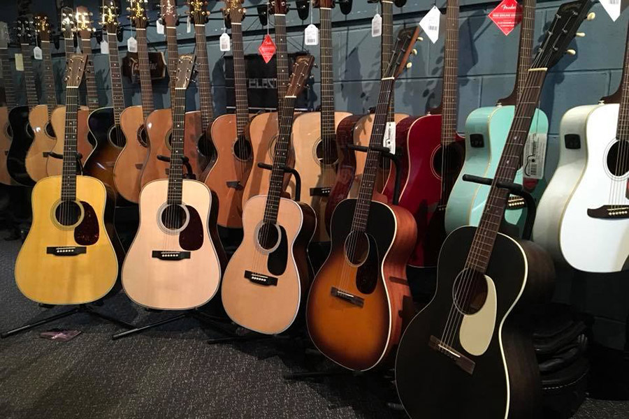 assorted acoustic guitars lined up