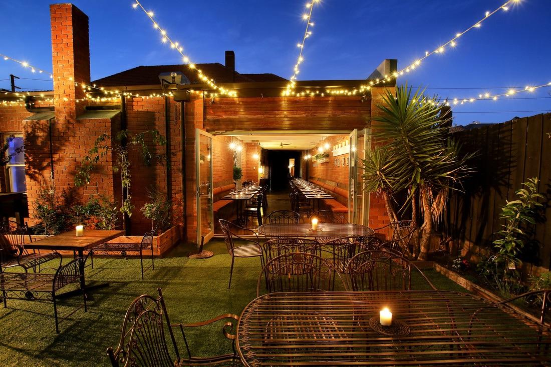le bon ton restaurant shot back garden dusk