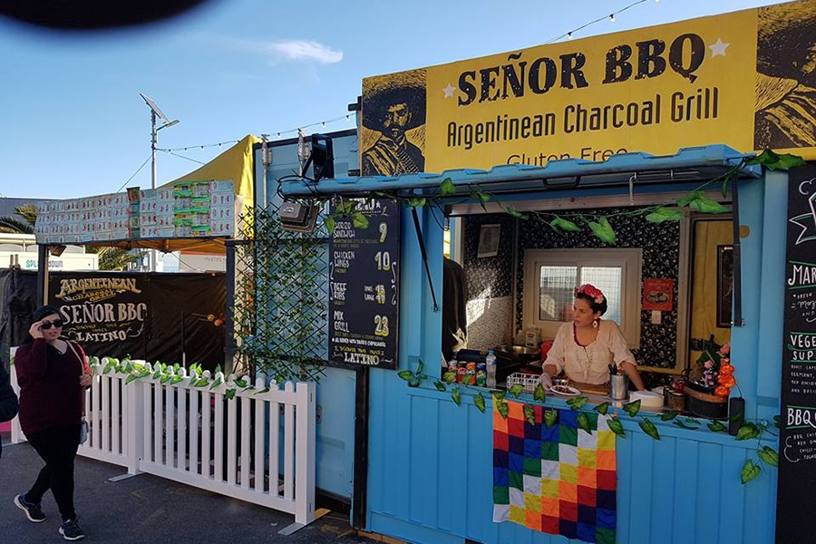 senor bbq shop front with woman in window
