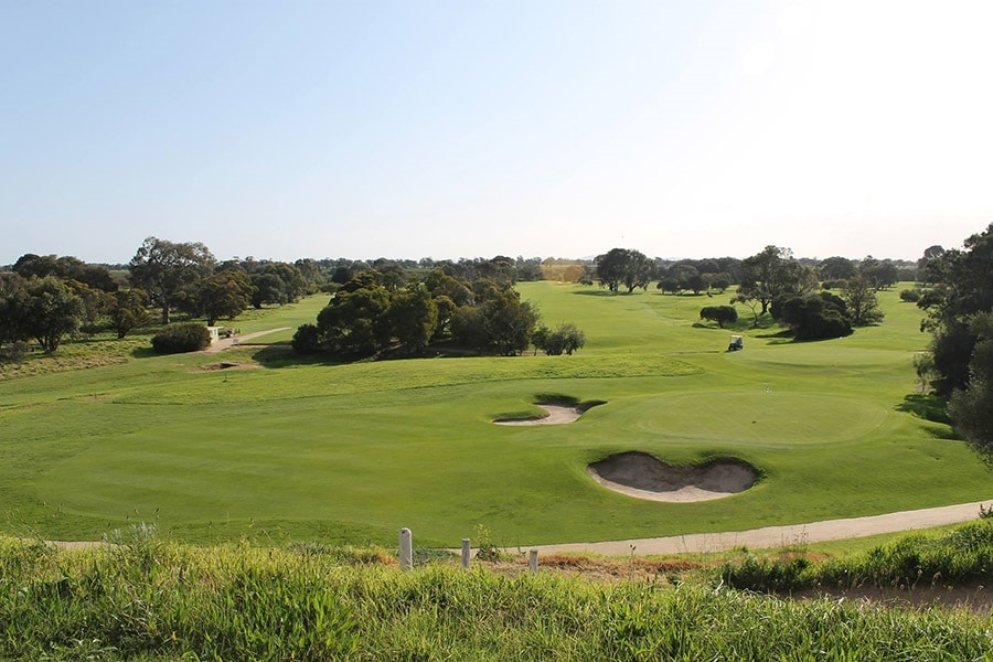 aerial shot of werribee golf course field
