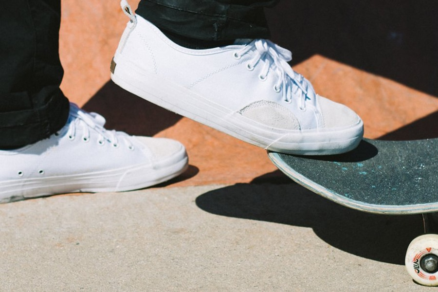 Shoes and skateboard close up
