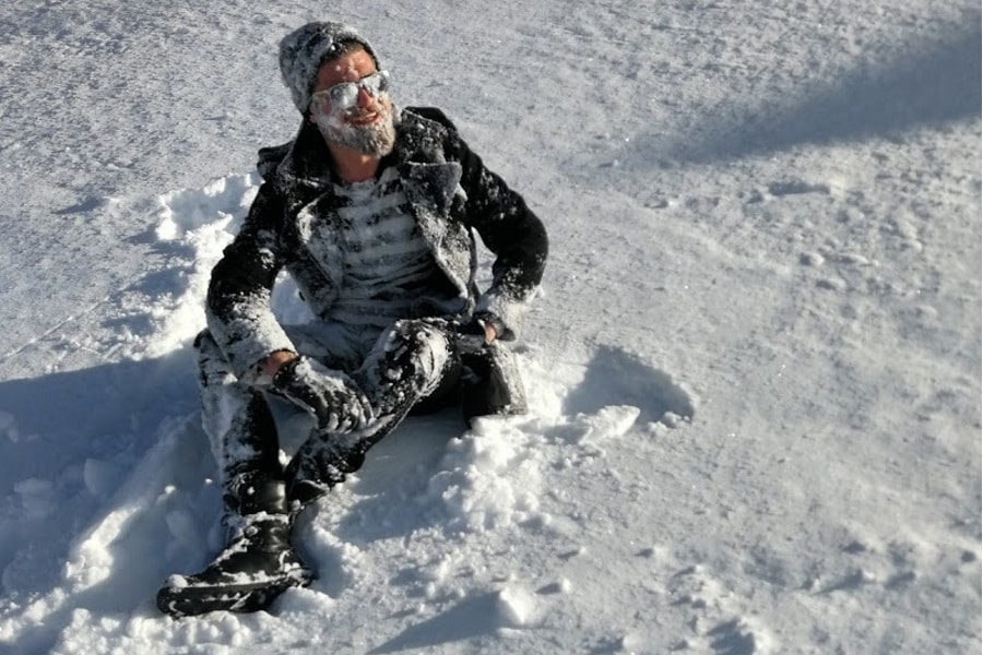 hot guy in snow winter fashion smiling