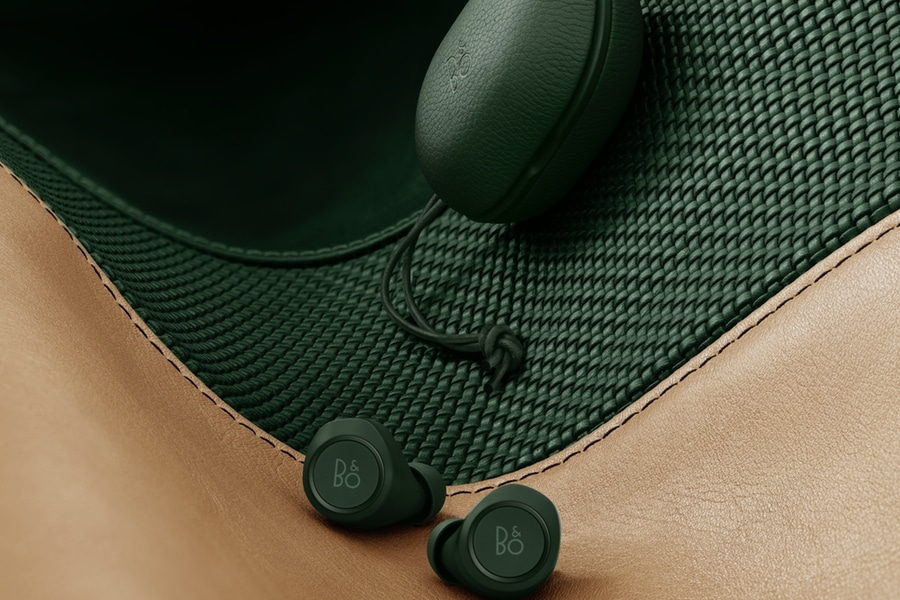 bang and olufsen's beoplay e8 earbuds on seat