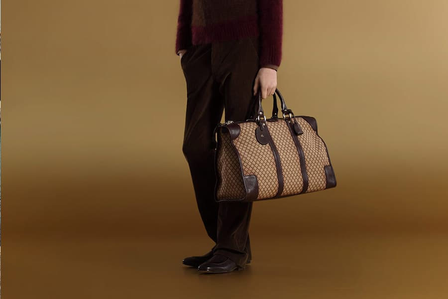 Gucci men's signature carry-on hand bag