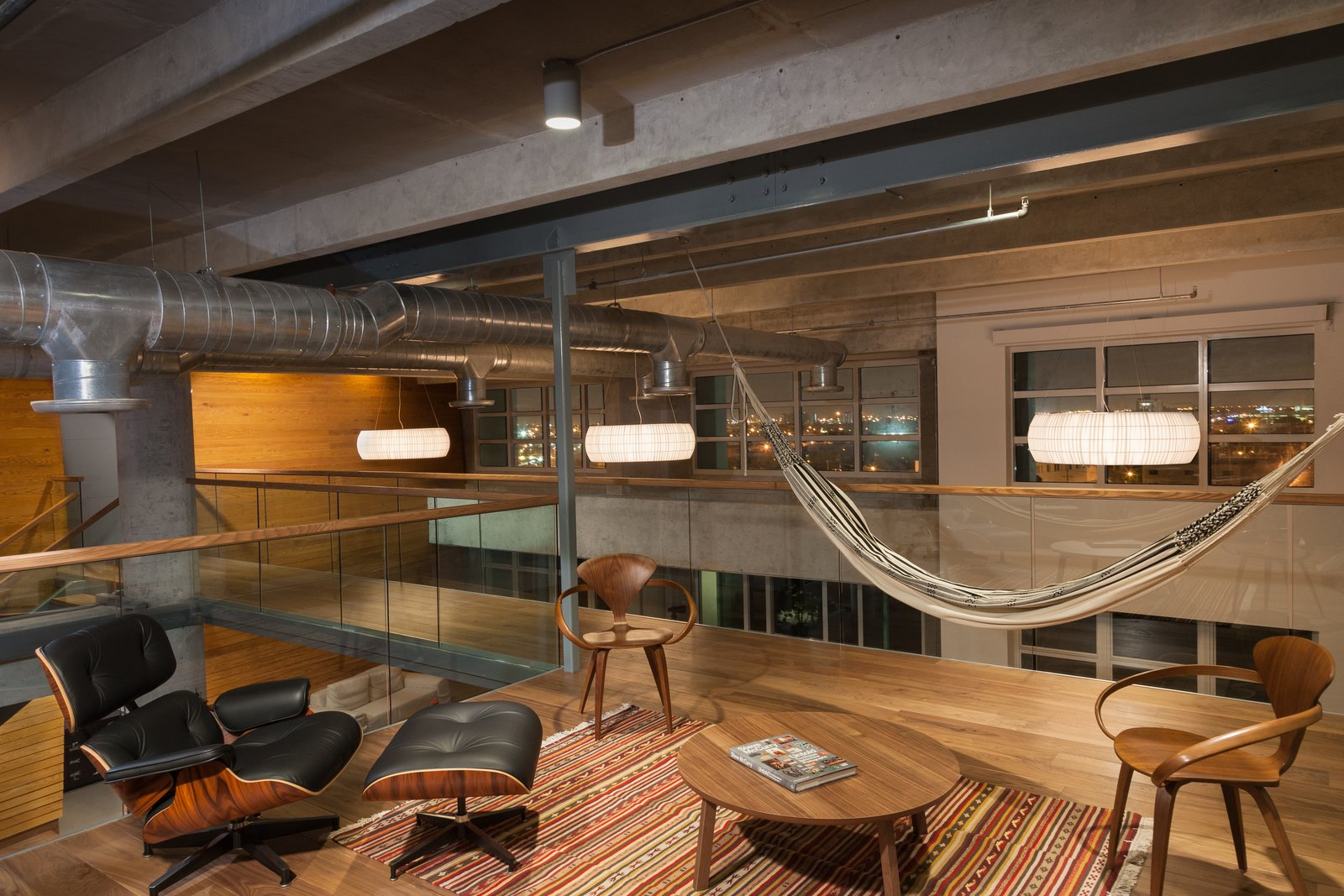 eames lounge chair and hammock in office