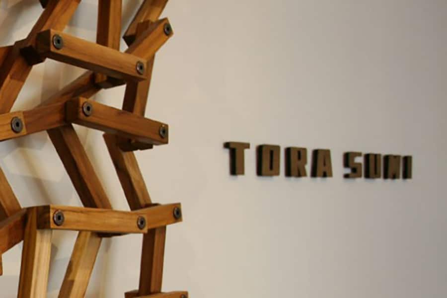 wooden tora sumi sign with abstract wooden artwork