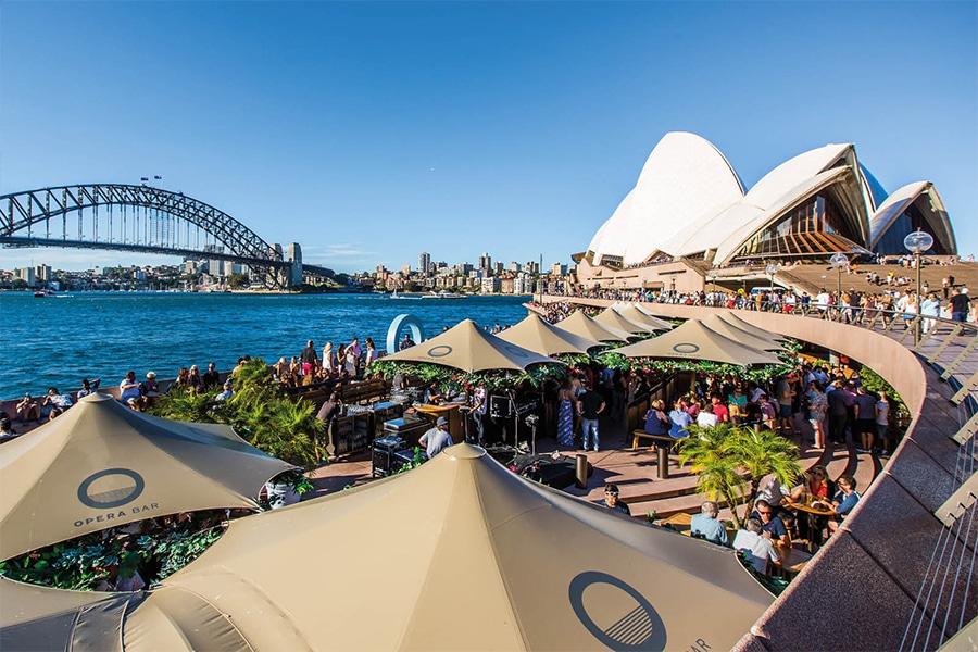 opera bar under umbrellas with opera house
