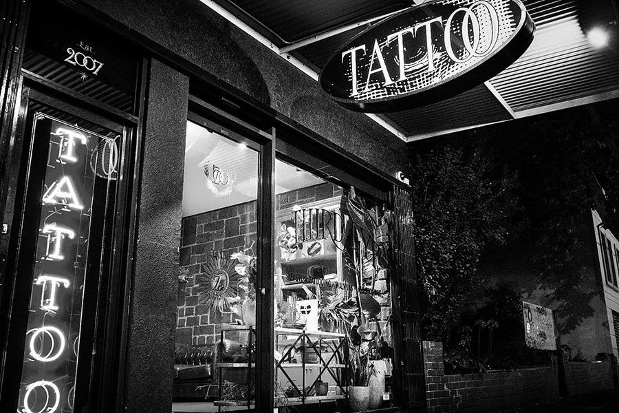 black and white third eye tattoo shopfront