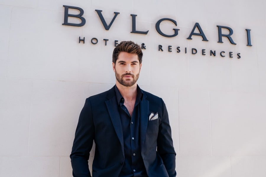 bvlgari fragrance men standing with wearing suit