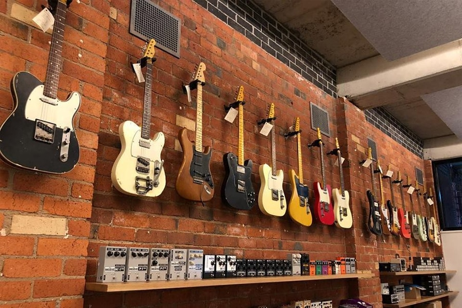 guitars hanging on wall