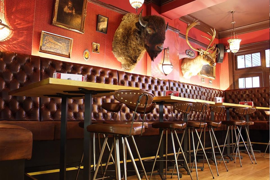 keg and brew interior with moose and deer head on wall