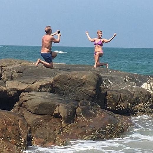 instagram boyfriend taking photo beside ocean