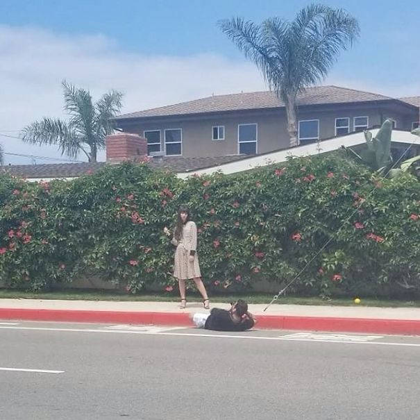 instagram boyfriend taking photo lying on the road