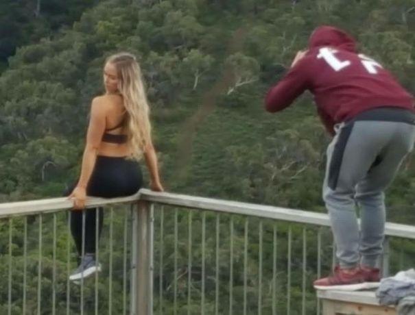 women sitting on railing